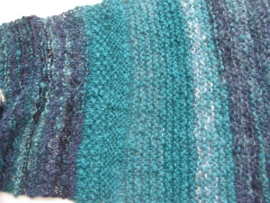 a home made knitted scarf